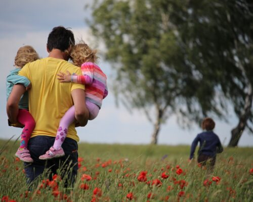 Man in Field with Family
