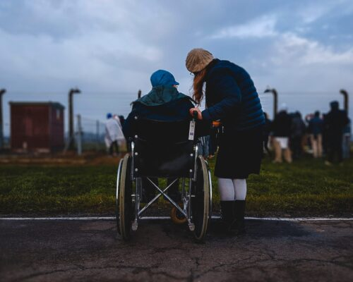Woman in Wheelchair with Friend