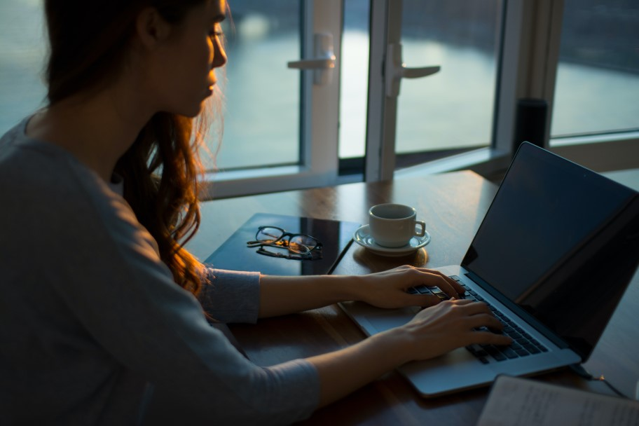 woman at home working on laptop
