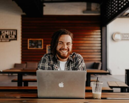 man smiling with laptop