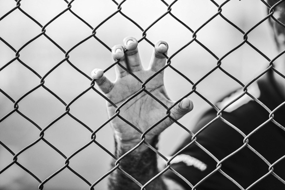 Hand on a fence