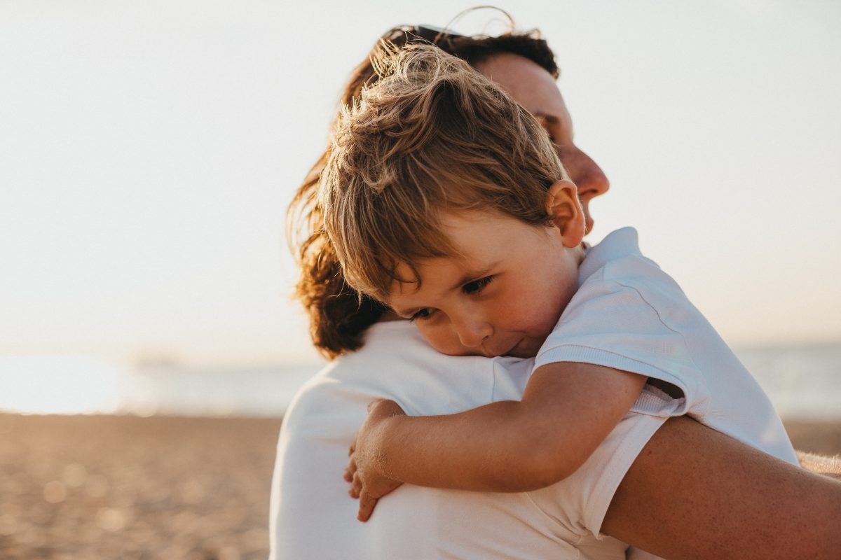 small child in woman's arms