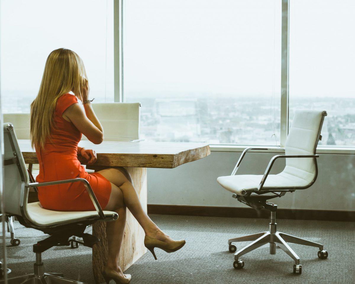 woman sitting in board room on phone